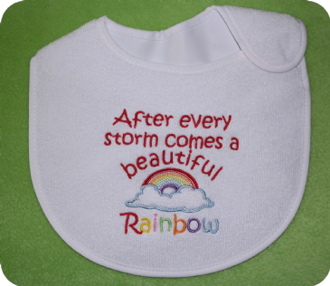 After every storm comes a beautiful rainbow - embroidered baby bib